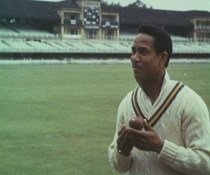 Sir Gary Sobers picks the ball up