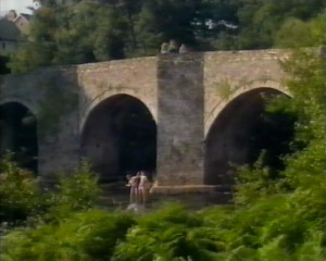 The Lloyd twins have gonw paddling in the river - the others watch from the bridge