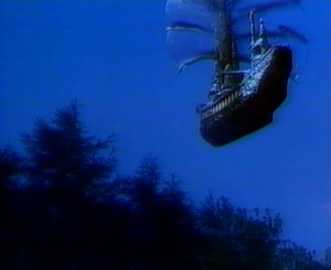 In the sky, the sailing ship that took Bethan is seen floating away