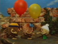 Pootle does not want any help blowing up his balloon
